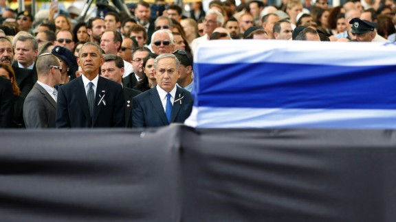 US President Barack Obama stands alongside Netanyahu as both men pay their respects.
