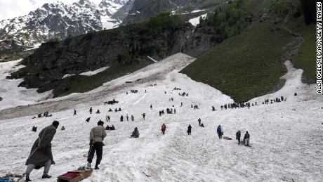 Visitors walk up the Thajiwas glacier in Sonamarg in Kashmir.