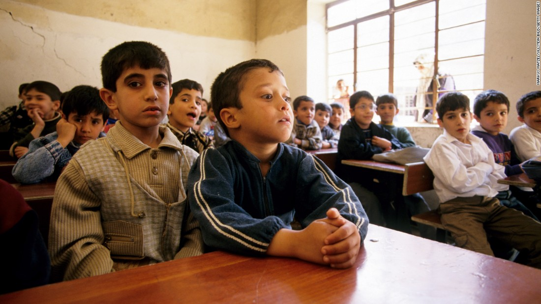 Children at a school in Mosul in 2002. ISIS developed its own curriculum after it took control of the city in 2014.