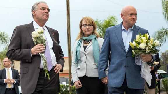 U.S. Sen. Tim Kaine, left, joins former U.S. Rep. Gabby Giffords and her husband, Mark Kelly, at a memorial site for victims of the Pulse nightclub shooting in Orlando. They made the visit on Monday, September 26 -- more than two months after the worst mass shooting in U.S. history.