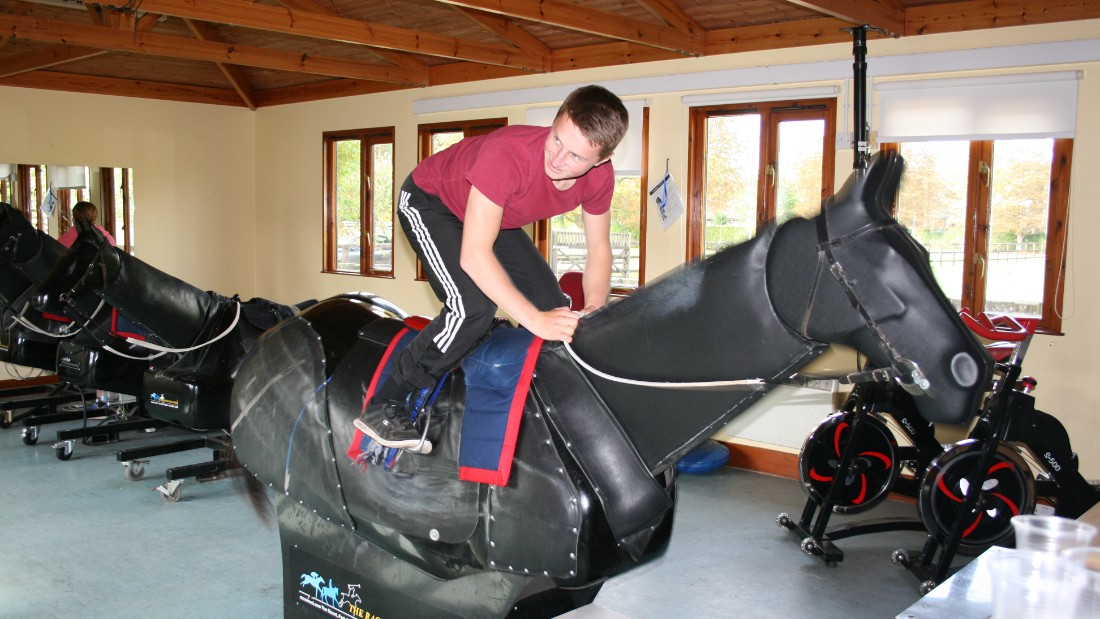 "These days, jockeys in the UK are required to pass a fitness test in order to receive their racing license. Here, reigning <a href=""http://www.britishchampionsseries.com"" target=""_blank"">Stobart Champion Apprentice Jockey</a>, Tom Marquand, demonstrates an exercise on a mechanical horse."