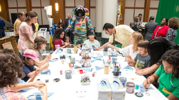 The Hope suit is unveiled at MD Anderson as children work on artwork.