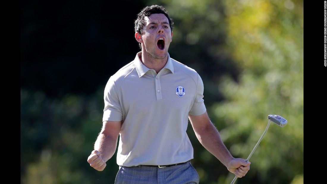 Rory McIlroy reacts after a putt on the tenth green during afternoon fourball matches.
