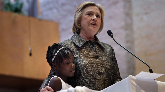 Democratic presidential nominee Hillary Clinton stands with Zianna Oliphant, age 9, while speaking during a Sunday service at Little Rock AME Zion Church in Charlotte, North Carolina on October 2.