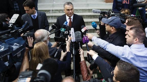 Hungarian Prime Minister Viktor Orban speaks to media after casting his vote.