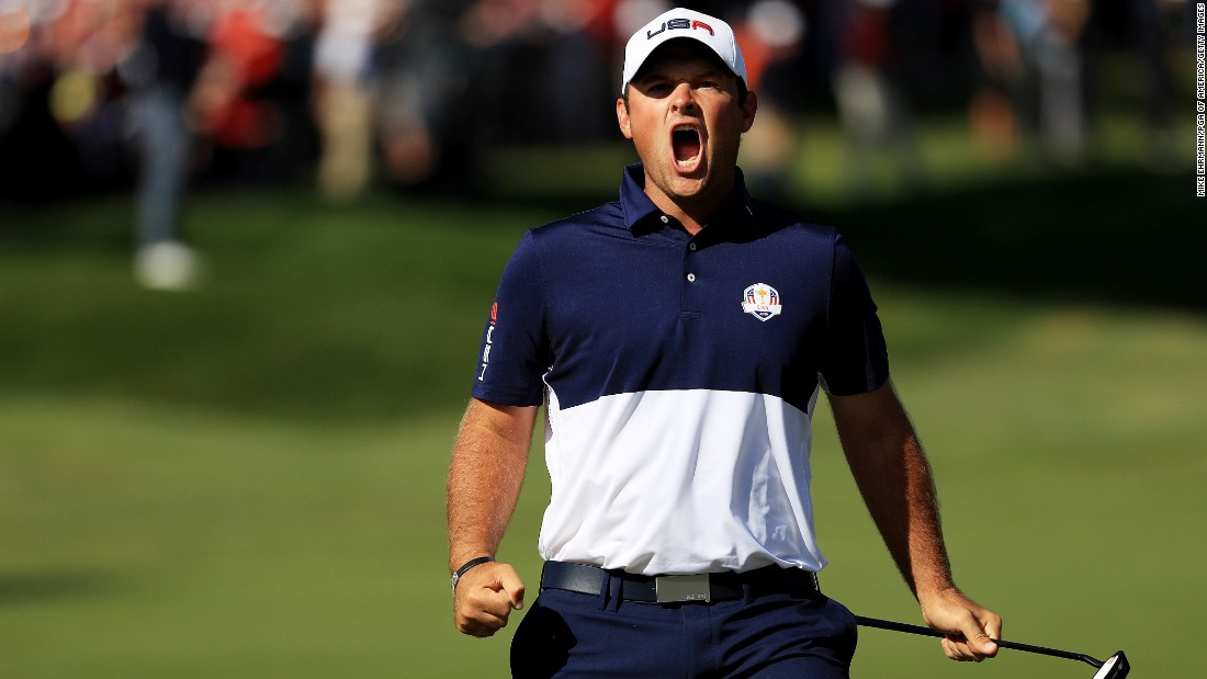 Patrick Reed of the United States reacts to making a putt on the first green. His victory over Rory McIlroy in the top match proved crucial.