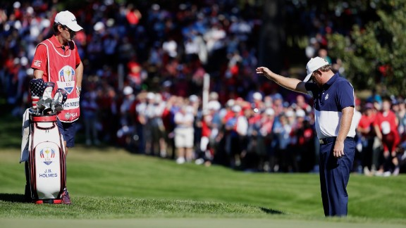 J.B. Holmes of the United States takes a drop on the eighth hole.