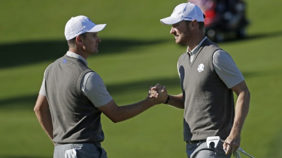 Justin Rose congratulates Chris Woods on his putt on the 10th hole, but both were to go down to final day defeats.