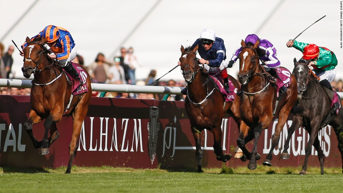 Ryan Moore, riding Found, charged clear to win The Qatar Prix de l'Arc de Triomphe at Chantilly racecourse in Paris.