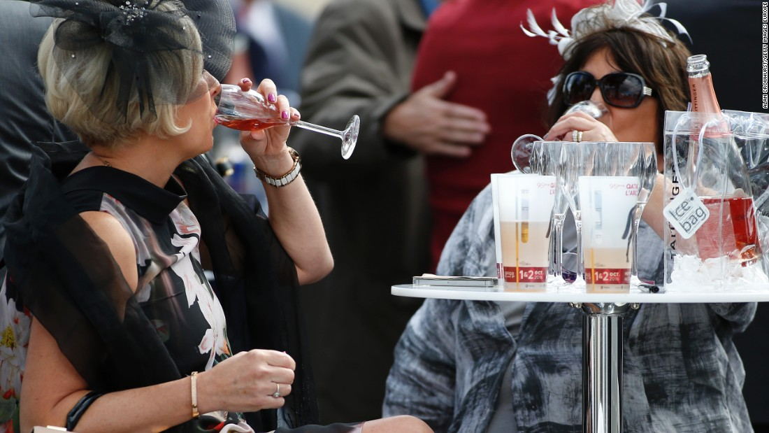 Racegoers enjoy a drink at Chantilly racecourse ahead of Europe's richest horse race.
