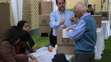 Picture released by Andina showing a Colombian citizen casting his vote at the Colombian consulate in Lima, Peru, for the referendum on whether to ratify a historic peace accord to end Colombia's 52-year war between the state and the communist FARC rebels, on October 2, 2016. The accord will effectively end what is seen as the last major armed conflict in the Western Hemisphere. The war has killed hundreds of thousands of people and displaced millions. / AFP PHOTO / ANDINA / STRSTR/AFP/Getty Images