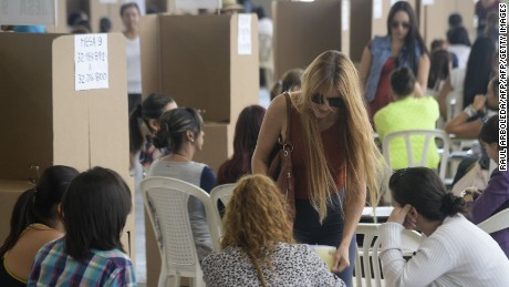 A woman casts her vote at a polling station during the referendum on whether to ratify a historic peace accord to end a 52-year war between the state and the communist FARC rebels, in Medellin, Colombia, on October 2, 2016. The accord will effectively end what is seen as the last major armed conflict in the Western Hemisphere. The war has killed hundreds of thousands of people and displaced millions. / AFP PHOTO / Raul ARBOLEDARAUL ARBOLEDA/AFP/Getty Images