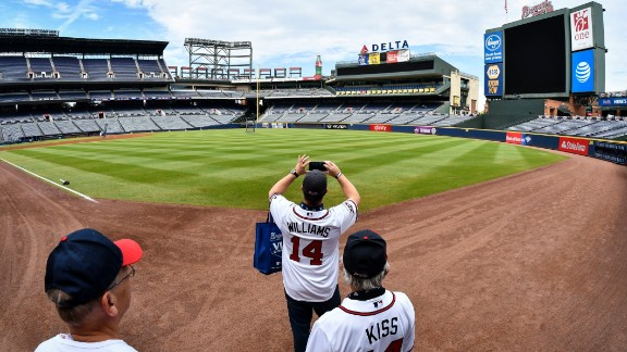Brett Williams shoots a photo as he and Jim Kiss take a tour of Turner Field led by Bill Hardman, before the Braves' last baseball game there against the Detroit Tigers on Sunday, October 2, in Atlanta. The franchise is planning to start the 2017 season at SunTrust Park, which is under construction in Cobb County, north of Atlanta.