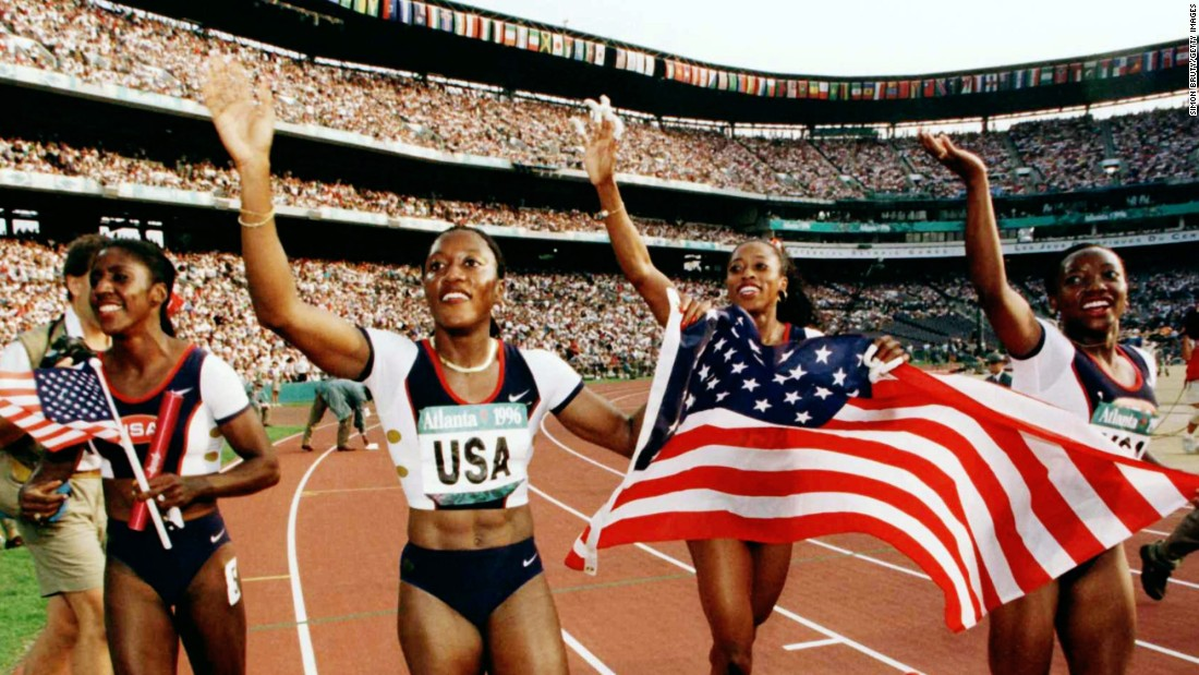 Before it was Turner Field, it was Centennial Olympic Stadium, the main venue for the 1996 Summer Olympic Games. At the Games' opening ceremony, millions from around the world joined those in the stands to watch as Muhammad Ali, his hands shaking from Parkinson's disease, lit the Olympic cauldron. Here, the USA 4x100 relay team of Gwen Torrance, Inger Miller, Gail Devers and Christy Gains celebrate after winning the gold medal.