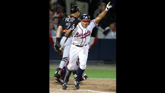 """October 19, 1999: The Braves reached the World Series in dramatic fashion. In Game 6 of the NLCS against the New York Mets, Atlanta coughed up a four-run lead but eventually won 10-9 in the bottom of the 11th inning when Andruw Jones walked with the bases loaded. It was the only year a World Series was held at """"The Ted."""" The New York Yankees swept the Braves in four games."""