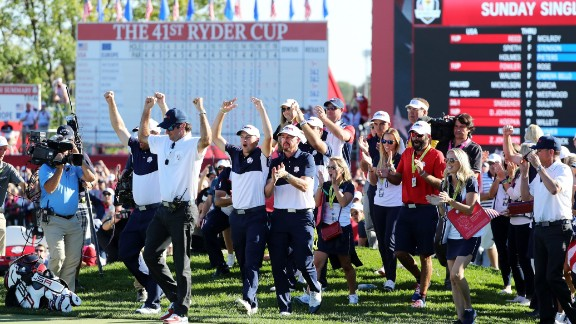 US players celebrate on the 18th green as their team closed out victory over Europe.