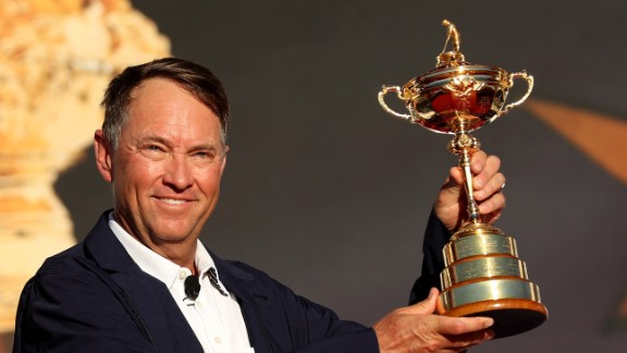 US captain Davis Love III holds the Ryder Cup aloft after his team beat Europe in the 2016 edition.