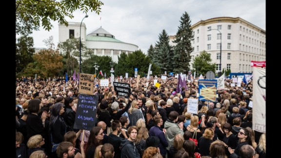 A crowd gathers outside the parliament building in the Polish capital on Saturday as part of the concern over the proposed legislation.
