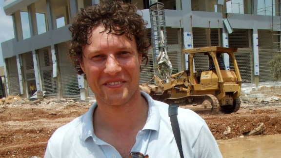 """This picture taken on July 14, 2006 shows Dutch Journalist Jeroen Oerlemans posing for a photograph while on assignment in Beirut.    A Dutch journalist was killed by sniper fire on October 2, 2016 while covering clashes in Libya's coastal city of Sirte, as unity government forces battled Islamic State group holdouts in the jihadist bastion.Dr Akram Gliwan, spokesman for a hospital in Misrata where pro-government fighters are treated, told AFP that photographer Jeroen Oerlemans was """"shot in the chest by an IS sniper while covering battles in Sirte"""" 450 kilometres (280 miles) east of Tripoli.  / AFP PHOTO / ANP / HARALD DOORNBOS / Netherlands OUTHARALD DOORNBOS/AFP/Getty Images"""