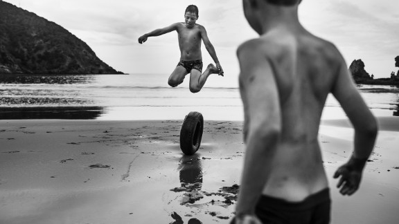 Two boys play on a beach in rural New Zealand. Niki Boon has been photographing her four home-schooled children as they explore the family
