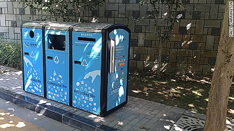 Public trash bins are solar powered and double as compactors.