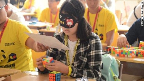 Cubers also compete blindfolded.