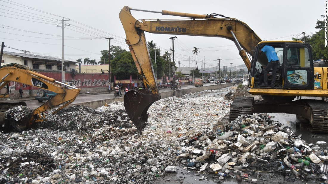 A backhoe removes garbage to clear a canal in Port-au-Prince on October 3.