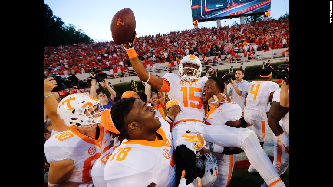 "Tennessee wide receiver Jauan Jennings is carried by his teammates after <a href=""http://bleacherreport.com/articles/2667024-tennessee-stuns-georgia-with-game-winning-hail-mary"" target=""_blank"">catching a Hail Mary pass</a> to win at Georgia on Saturday, October 1. Jennings' amazing catch came just seconds after Georgia hit a long touchdown pass of its own."