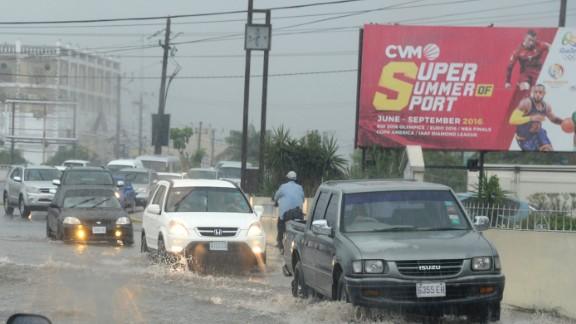 Motorists drive through heavy rains in Kingston, Jamaica, on October 2.