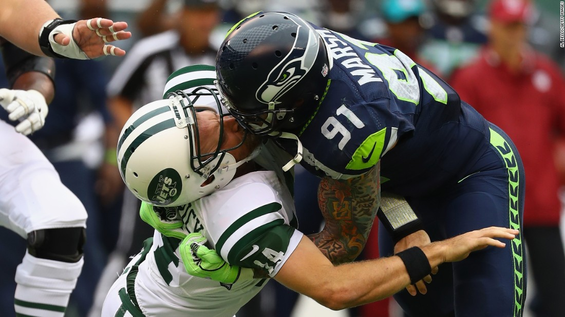 Seattle's Cassius Marsh got a roughing-the-passer penalty for this hit on New York Jets quarterback Ryan Fitzpatrick on Sunday, October 2.