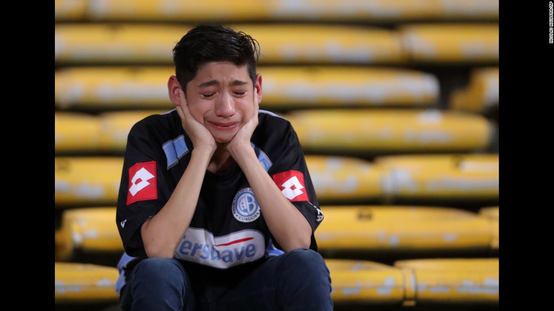 A fan cries after Argentine soccer club Belgrano lost a Copa Sudamericana match against Coritiba on Thursday, September 29.