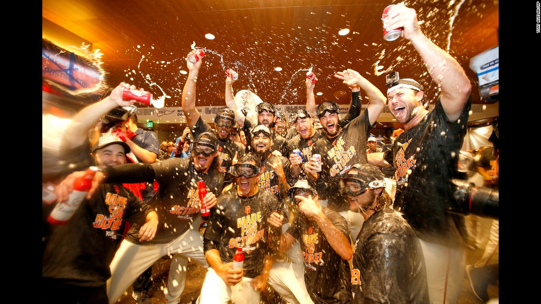 The San Francisco Giants celebrate in the clubhouse after clinching a playoff spot on Sunday, October 2. The Giants will play the New York Mets in the National League's wild-card game.