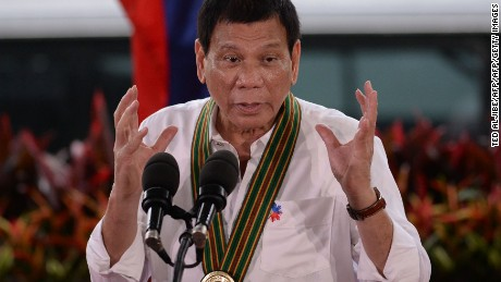 "Philippine President Rodrigo Duterte gestures as he delivers a speech during a ""talk to the troops"" visit to meet military personnel in Manila on October 4, 2016. Rodrigo Duterte launched a fresh tirade at the United States on October 4, telling Barack Obama to ""go to hell"" as the longtime allies launched war games that the firebrand Philippine leader warned could be their last. / AFP / TED ALJIBE        (Photo credit should read TED ALJIBE/AFP/Getty Images)"