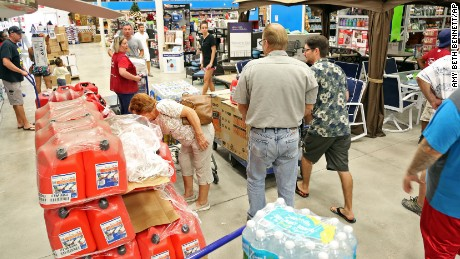 Shoppers look for items amid the generators, cases of water and gas cans at Lowe's in Oakland Park, Fla., Tuesday, Oct. 4, 2016. Anxious Florida residents raided grocery store shelves and North Carolina called for the evacuation of three barrier islands as Hurricane Matthew, the most powerful Atlantic storm in a about decade, threatened to rake a large swath of the East Coast in the coming days. (Amy Beth Bennett/South Florida Sun-Sentinel via AP)