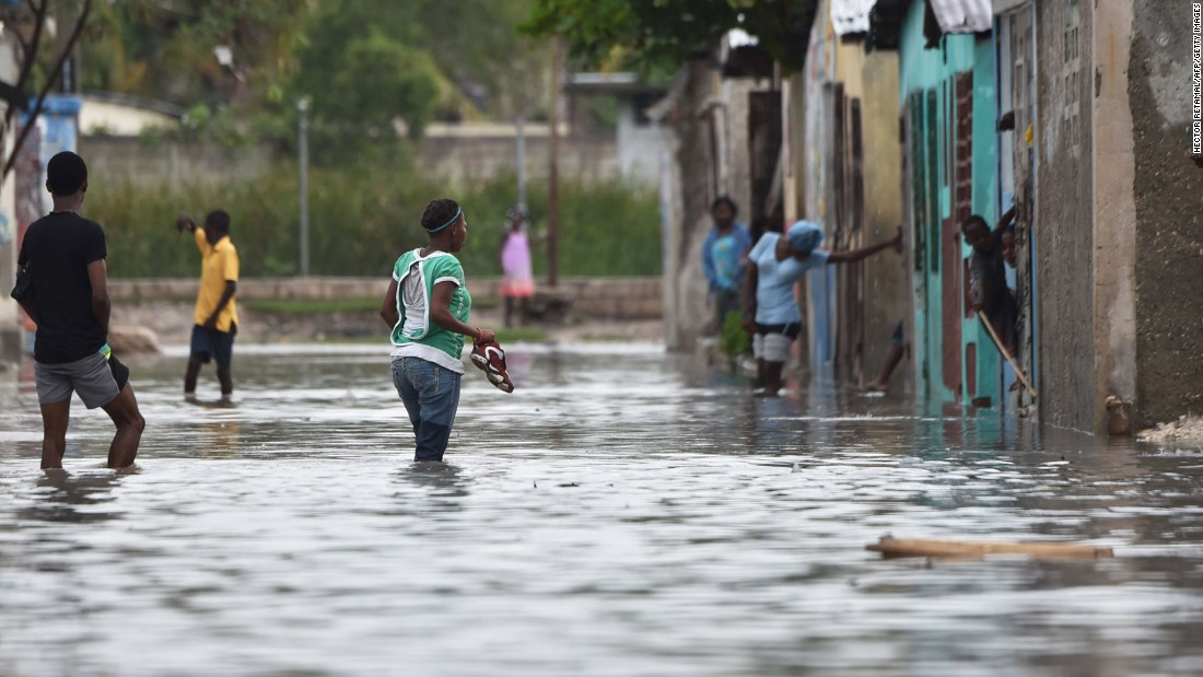 People wade through the flooded streets of Cite Soleil in the Haitian capital of Port-au-Prince on October 4. Hurricane Matthew is the strongest storm to hit Haiti since 1964 and the first hurricane to make landfall in the country since the devastating earthquake in 2010.