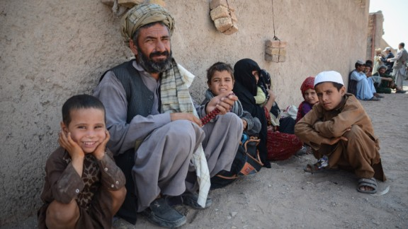"""Ghousuddin, 50, and his wife and five children fled fighting in Helmand and headed for Herat.  In the rush to leave, there was no time to put shoes on his youngest child.  """"I wish for peace and security in my country,"""" said Ghousuddin.  """"Where shall I go with all these kids? I don"""