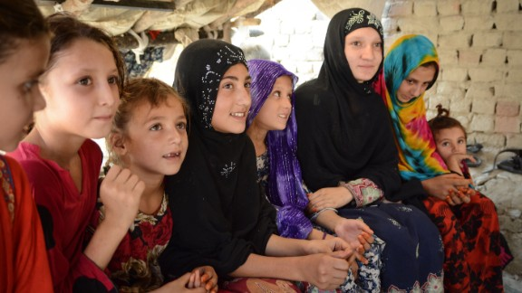 """Zaria (third from right) and her family recently returned to Afghanistan from Pakistan. However she has not yet been able to attend school.   """"I want to be educated and become a doctor,"""" she said, adding """"I hope to be able to go to school again."""""""