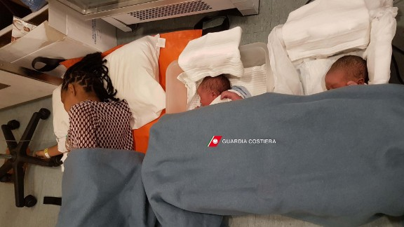 A photo released by the Italian coast guard shows babies born in a migrant rescue ship off the Sicilian coast.