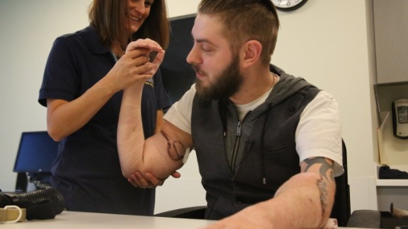 John Peck and occupational therapist Tiffany Pritchett at Spaulding Rehabilitation Network after Peck