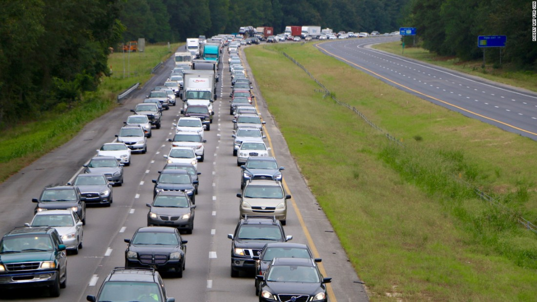 Bumper-to-bumper traffic lines Interstate 26 in Columbia, South Carolina, as people drive west on October 5.