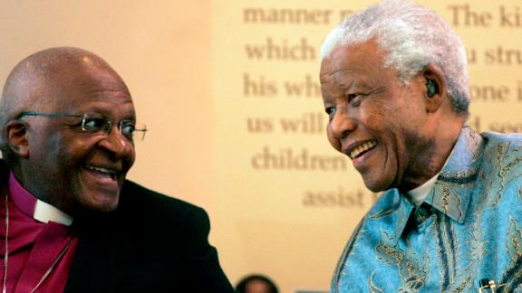 Tutu talks with Mandela at an event in Johannesburg in 2008.
