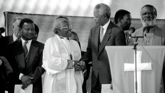 Tutu greets Mandela at a rally, weeks before South Africa's historic democratic election in 1994.