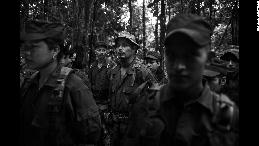 The morning call is issued at 4:30 a.m. for members of a FARC camp in Colombia's Meta Department. After an exercise session, the rebels sing the organization's hymn and their commander reads them the important news of the day. Photographer Fabio Cuttica spent time with the guerrillas in November.