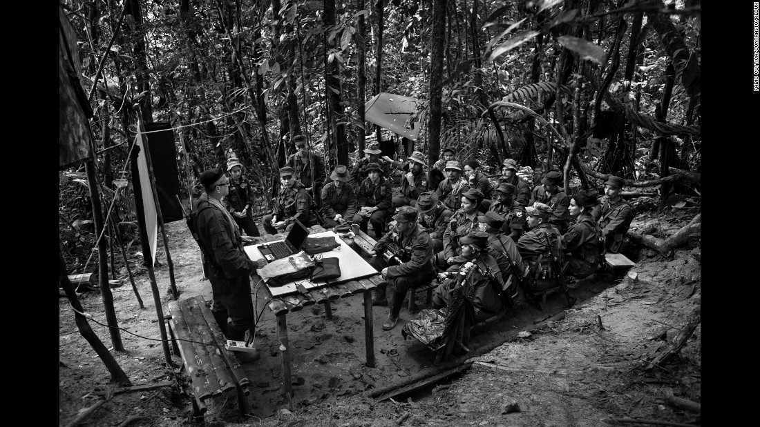 FARC negotiator Ruben Zamora briefs a group of rebels on a peace deal with the Colombian government. The country voted the peace deal down in a referendum this week.