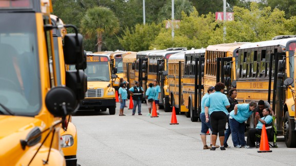 Bus drivers in North Charleston, South Carolina, wait for word to start evacuations.