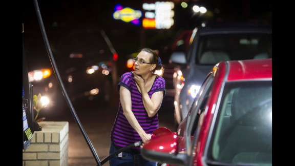 Beth Johnson fills up her car at a gas station in Mt. Pleasant, South Carolina, on October 4.