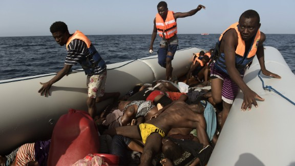 "Migrants step over dead bodies while being rescued in the Mediterranean Sea, off the coast of Libya in October 2016.  Agence France-Presse photographer Aris Messinis was on a Spanish rescue boat that encountered several crowded migrant boats. Messinis said the rescuers counted 29 dead bodies -- 10 men and 19 women, all between 20 and 30 years old. ""I"