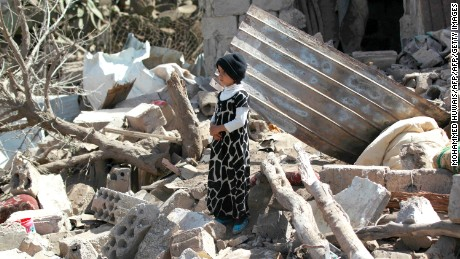 TOPSHOT - A Yemeni boy stands in the rubble of buildings destroyed in an air-strike by the Saudi-led coalition on February 25, 2016 in the capital Sanaa.  / AFP / MOHAMMED HUWAIS        (Photo credit should read MOHAMMED HUWAIS/AFP/Getty Images)