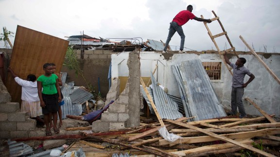 Residents repair their homes in Les Cayes, Haiti, on October 6. The damage from Hurricane Matthew was especially brutal in southern Haiti, where sustained winds of 130 mph punished the country.