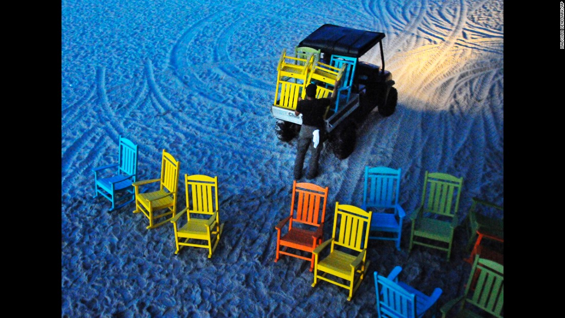 3ec279392656 Workers start removing umbrellas and the colorful rocking chairs that line  the Cocoa Beach Pier in
